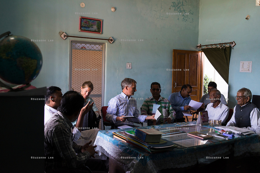 Fairtrade personnel from Switzerland make a presentation to a small group of Fairtrade Cotton Farmer Leaders in Vasudha Vidya Vihar school in Khargone, Madhya Pradesh, India on 12 November 2014. Photo by Suzanne Lee for Fairtrade