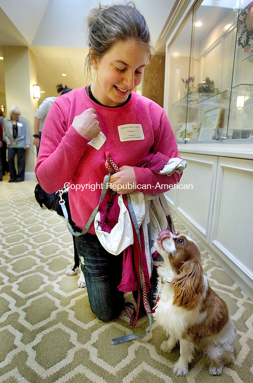 SOUTHBURY CT. 25 March 2014-032814SV11-Heather Dewey of Southbury and her dog, &ldquo;Sophie&rdquo;, get ready to compete during an indoor dog show at The Watermark at East Hill in Southbury Friday. <br /> Steven Valenti Republican-American