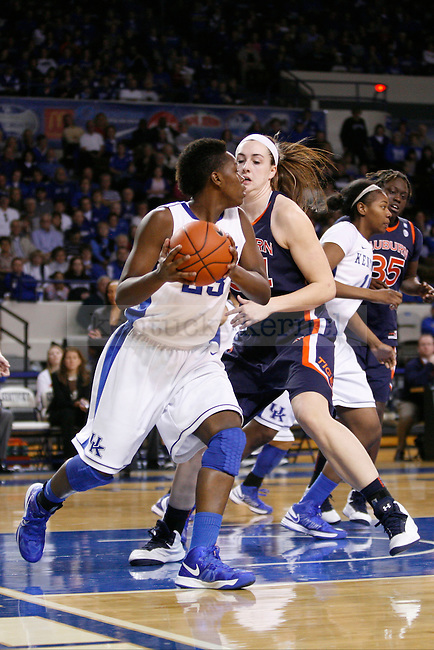 UK junior forward Samarie Walker looking to pass the ball while being guarded by Auburn junior center Peyton Davis  during the second half of the UK Hoops vs. Auburn women's basketball game at Memorial Coliseum on Sunday, January 20, 2013, in Lexington, Ky. Photo by Kalyn Bradford | Staff