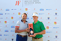 Sir Rocco Forte presents Pontus Widegren (SWE) with a bottle of champagne for his hole in one on the 15th hole during the third round of the Rocco Forte Sicilian Open played at Verdura Resort, Agrigento, Sicily, Italy 12/05/2018.<br /> Picture: Golffile | Phil Inglis<br /> <br /> <br /> All photo usage must carry mandatory copyright credit (&copy; Golffile | Phil Inglis)
