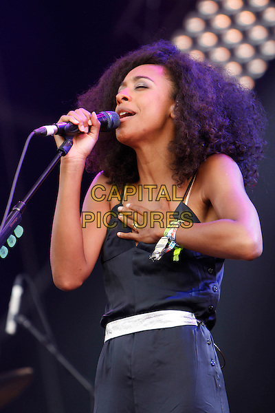 CORINNE BAILEY RAE .Performs at Hyde Park Calling - Day 2, London, England, UK, 26th June 2010..live music gig on stage festival concert.half length microphone black catsuit pantsuit buttons singing hand.CAP/MAR.©Martin Harris/Capital Pictures.