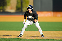 Pat Blair (11) of the Wake Forest Demon Deacons takes his lead off of first base against the West Virginia Mountaineers at Wake Forest Baseball Park on February 24, 2013 in Winston-Salem, North Carolina.  The Demon Deacons defeated the Mountaineers 11-3.  (Brian Westerholt/Four Seam Images)