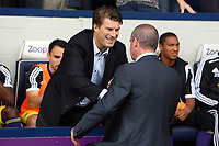Pictured L-R: Swansea manager Michael Laudrup greets West Brom manager Steve Clarke. Sunday 01 September 2013<br />