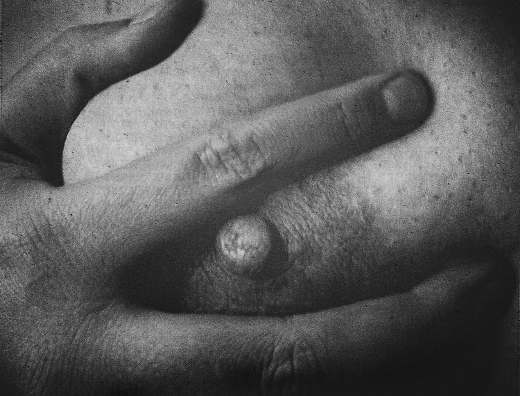 A woman's breast and hand