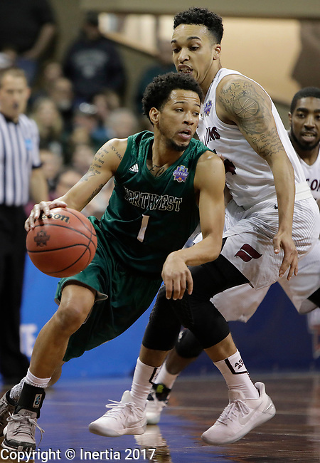 SIOUX FALLS, SD: MARCH 25:  Justin Pitts #1 of Northwest Missouri State drives around Fairmont State defender D'Ondre Stockman #14 during the Men's Division II Basketball Championship game on March 25, 2017 at the Denny Sanford Premier Center in Sioux Falls, SD. (Photo by Dick Carlson/Inertia)