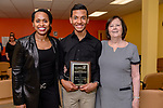 WATERBURY, CT. 07 May 2018-050718BS20 - From left, Waterbury Youth Services Board of Director Gradia McKinney, and WYS Executive Director Kathi Crowe, right, stand with Waterbury Arts and Magnet School student Marco De Los Santos-Garcia of Waterbury, after he was recognized and received an award during the 15th Annual Excellence in Youth Awards at the Waterbury Youth Services on Monday evening. Bill Shettle Republican-American