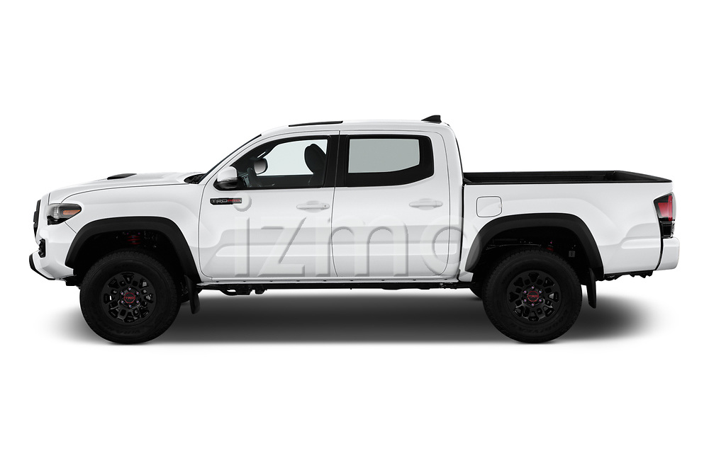 Car driver side profile view of a 2019 Toyota Tacoma TRD Pro 4 Door Pick Up