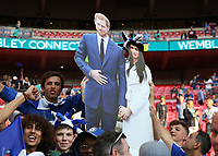 19th May 2018, Wembley Stadium, London, England; FA Cup Final football, Chelsea versus Manchester United; Chelsea fans hold up in celebration a giant cardboard cutout of HRH Prince Harry and Megan Markle