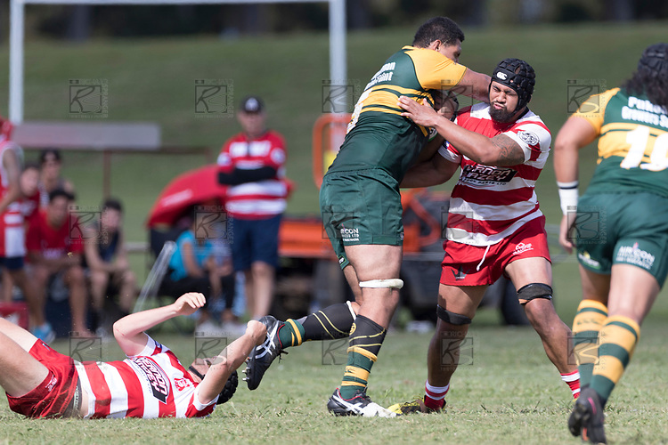 Cameron Skelton leaves Zachary Smith in his wake as he charges in to Melino Samate.  Counties Manukau Premier Counties Power Club Rugby game between Karaka and Pukekohe, played at the Karaka Sports Park on Saturday March 10th 2018. Pukekohe won the game 31 - 27 after trailing 5 - 20 at halftime.<br /> Photo by Richard Spranger.