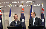 AUSTRALIA, Canberra : French President Francois Hollande (L) and Australian Prime Minister Tony Abbott (R) give statements at the Australian War Memorial, Canberra on November 19, 2014. Hollande is on a two-day state visit to Australia following the G20 Summit over the weekend. AFP PHOTO / MARK GRAHAM