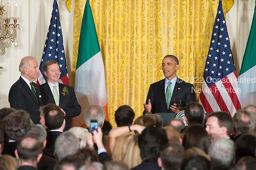 US President Barack Obama (R) delivers remarks beside US Vice President Joe Biden (L) and acting Prime Minister (Taoiseach) of Ireland Enda Kenny (2-L); during a reception for St. Patrick's Day in the East Room of the White House, in Washington, DC, USA, 15 March 2016. St. Patrick's Day takes place 17 March.<br /> Credit: Michael Reynolds / Pool via CNP