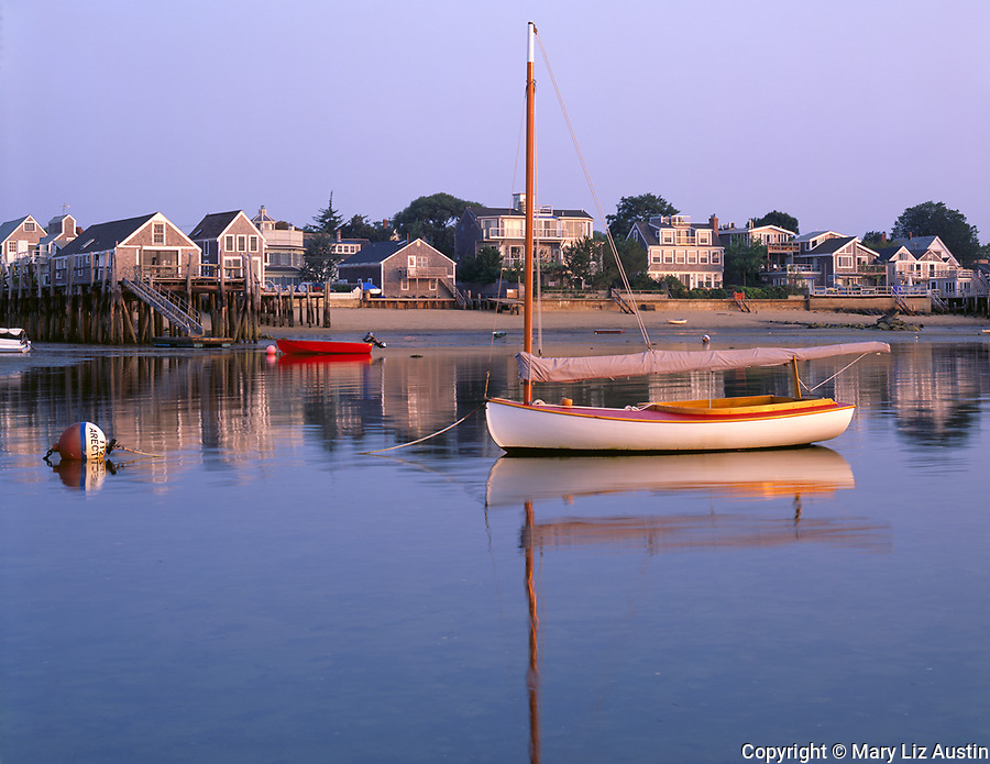 Cape Cod National Seashore, MA<br /> A sailboat moored at low tide in Provincetown Harbor at sunrise