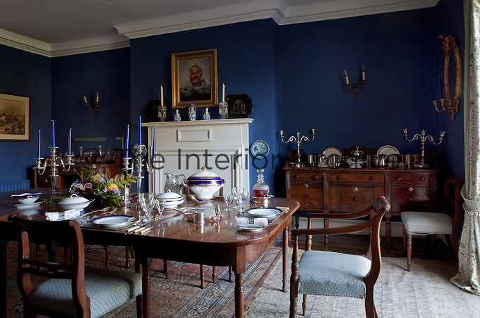 The Georgian dining room in the original part of the house is painted a royal blue