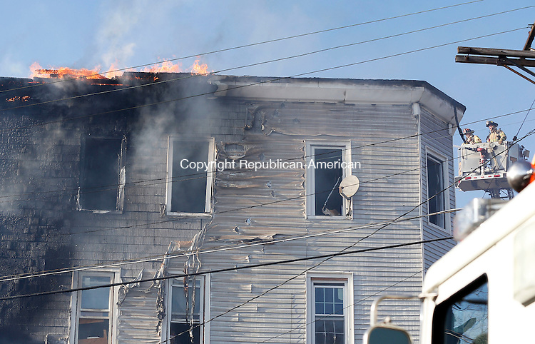 Waterbury, CT- 11 April 2015-041115CM19-   Waterbury firefighters battle a fire on Orange Street in Waterbury on Saturday.  An afternoon fire destroyed a multifamily house.   Christopher Massa Republican-American
