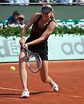 Maria Sharapova (RUS) defeats Shuai Peng (CHI) 6-2, 6-1.