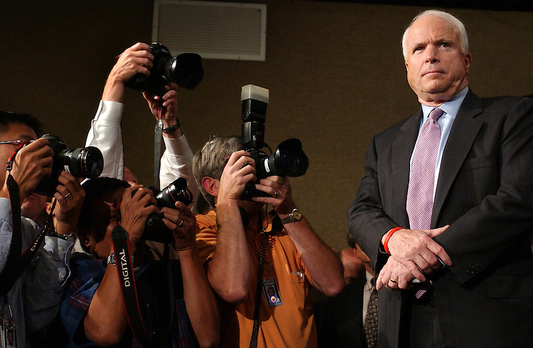 Sen. John McCain, R-Ariz., has his picture taken during a news conference with a group of bipartisan senators about the compromise reached with the filibuster issue.