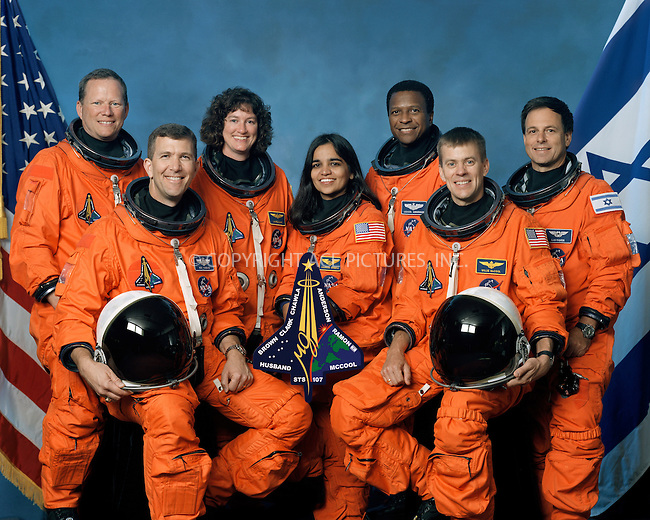 FILE PHOTO:  (October 2001) --- The seven STS-107 crew members take a break from their training regimen to pose for the traditional crew portrait. Seated in front are astronauts Rick D. Husband (left), mission commander; Kalpana Chawla, mission specialist; and William C. McCool, pilot. Standing are (from the left) astronauts David M. Brown, Laurel B. Clark, and Michael P. Anderson, all mission specialists; and Ilan Ramon, payload specialist representing the Israeli Space Agency. Supplied by NASA/NY Photo Press.   ....NY Photo Press:  ..phone (646) 267-6913;   ..e-mail: info@nyphotopress.com