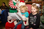 TORRINGTON, CT. 20 December 2019-122019BS13 - Dakota Secor, 3, center and her sister RaiLynn Kennedy, 5, right, both of Torrington sing Christmas carols while sitting on Santa's lap, during a visit by Santa at the FISH of Northwestern Connecticut Homeless Shelter in Torrington on Friday. Bill Shettle Republican-American