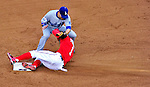 24 April 2010: Los Angeles Dodgers' infielder Jamey Carroll attempts to get Washington Nationals' center fielder Nyjer Morgan out at second but Morgan slides in safely at Nationals Park in Washington, DC. The Dodgers edged out the Nationals 4-3 in a thirteen inning game. Mandatory Credit: Ed Wolfstein Photo