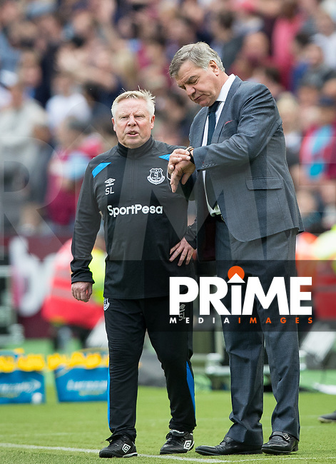 Everton Manager Sam Allardyce looks at his watch beside assistant Sammy Lee during the Premier League match between West Ham United and Everton at the Olympic Park, London, England on 13 May 2018. Photo by Andy Rowland / PRiME Media Images.