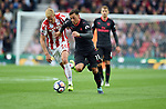 Mesut Ozil of Arsenal is challenged by Darren Fletcher of Stoke City during the premier league match at the Britannia Stadium, Stoke. Picture date 19th August 2017. Picture credit should read: Robin Parker/Sportimage