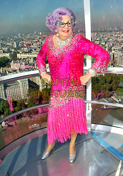 Barry Humphries aka Dame Edna Everage.Photocall for New Wimbledon Theatre's 2011 Pantomime 'Dick Whittington' held on the London Eye, London, England..September 29th 2011.panto pantomime full length costume pink dress glasses purple rinse wig hands on hips sequins sequined   .CAP/JIL.©Jill Mayhew/Capital Pictures