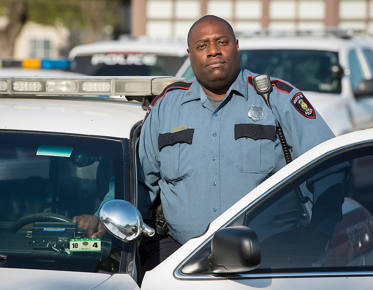 Houston ISD Police Officer Quentin Flannel poses for a photograph March 25, 2014.