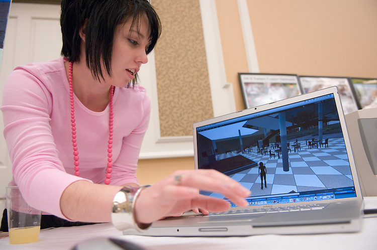 """Meghan Louttit, demonstrates Ohio University's Campus on Second Life..Ist Annual Outreach Expo..Celebrate teaching, research and service in Appalachian Ohio.Two-day event showcases Ohio University partnerships throughout the region.ATHENS, Ohio (April 3, 2007) -- Ohio University stands out for its deep commitment to serve local and regional communities around it. At an upcoming expo and conference, learn about the wide-ranging community partnerships and the impact they are making every day...The Office for University Outreach event, held April 13 to 14 in the Baker University Center Ballroom, will encourage university and local community members to explore existing partnerships and create new ones...On Friday, April 13, the Outreach EXPO will showcase the work of more than 50 exhibitors with relationships in the region. Groups such as Kids on Campus and African Americans in the Ohio River Valley as well as individual researchers from Athens and regional campuses will share posters. Athens group Rattletrap Stringband, which calls itself a """"blues, ragtime, hillbilly"""" band, will add local color to the event...Emphasizing the focus on Appalachia, """"Grandmother of Appalachian Studies"""" Helen Lewis will present a keynote lecture Friday evening. Lewis is past president of the national organization Appalachian Studies Association and has taught at more than half a dozen Appalachian colleges and universities...The event continues on Saturday, April 14, with the conference """"A Celebration of Teaching, Research and Service in Appalachian Ohio."""" It will include panels about education, research and service in Appalachia as well as a brainstorming session about a potential Ohio University Appalachian studies program...Faculty, staff, students and community members are encouraged to attend the event. Attendees must RSVP for Saturday's conference by e-mailing outreach@ohio.edu by Friday, April 6. For more information and a schedule, visit www.outreach.ohio.edu/events.htm."""