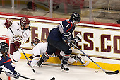 Grace Bizal (BC - 2), Lexi Bender (BC - 21), Brittany Berisoff (UConn - 11) - The Boston College Eagles defeated the visiting UConn Huskies 4-0 on Friday, October 30, 2015, at Kelley Rink in Conte Forum in Chestnut Hill, Massachusetts.