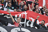 BOGOTÁ-COLOMBIA-22-04-2015. Hinchas de Atlas de Mexico animan a su equipo durante el encuentro con Independiente Santa Fe de Colombia por la segunda fase, llave G1, de la Copa Bridgestone Libertadores 2015 jugado en el estadio Nemesio Camacho El Campin, de la ciudad de Bogota. / Followers of Atlas de Mexico cheer their team during the match against Independiente Santa Fe de Colombia for the second phase, G1 key, of the Copa Bridgestone Libertadores 2015 played at Nemesio Camacho El Campin stadium in Bogota city.  Photo: VizzorImage/ Gabriel Aponte /Staff