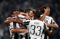 Calcio, Champions League: Gruppo H, Juventus vs Lione. Torino, Juventus Stadium, 2 novembre 2016. <br /> Juventus&rsquo; Gonzalo Higuain, third from left, celebrates with teammates after scoring on a penalty kick during the Champions League Group H football match between Juventus and Lyon at Turin's Juventus Stadium, 2 November 2016. The game ended 1-1.<br /> UPDATE IMAGES PRESS/Isabella Bonotto