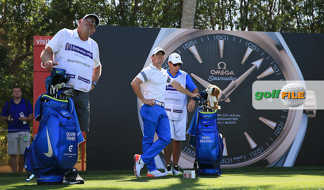 The Omega tee; Rory McIlroy (NIR) and Oliver Fisher (ENG) in action during Round Three of the 2016 Omega Dubai Desert Classic, played on the Emirates Golf Club, Dubai, United Arab Emirates.  06/02/2016. Picture: Golffile | David Lloyd<br /> <br /> All photos usage must carry mandatory copyright credit (&copy; Golffile | David Lloyd)