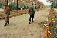 Two man walking, Parque Del Retiro, Madrid, Spain.