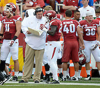 STAFF PHOTO ANTHONY REYES &bull; @NWATONYR<br /> Bret Bielema, Arkansas head coach talks to Denzell Evans against Nicholls State in the first quarter Saturday, Sept. 6, 2014 at Razorback Stadium in Fayetteville.