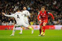 Real Madrid´s Sergio Ramos and Sevilla's Gerard Lazaro during 2014-15 La Liga match between Real Madrid and Sevilla at Santiago Bernabeu stadium in Alcorcon, Madrid, Spain. February 04, 2015. (ALTERPHOTOS/Luis Fernandez) /NORTEphoto.com