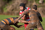 Ross Turnbull is very quickly going to get that muddy look as he is tackled by Alipini Olosoni & Jone Raqamate. Counties Manukau Premier Club Rugby game between Patumahoe & Karaka played at Patumahoe on Saturday June 13th 2009. Patumahoe lead 8 - 0 at halftime and went on to win 20 - 0.