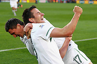 Zlatan Ljubijankic of Slovenia celebrates scoring the second goal against USA