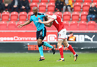 Michael Smith of Rotherham United pushes Nathan Pond of Fleetwood Town during the Sky Bet League 1 match between Rotherham United and Fleetwood Town at the New York Stadium, Rotherham, England on 7 April 2018. Photo by Leila Coker.