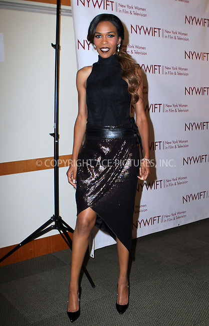 ACEPIXS.COM<br /> <br /> June 18 2014, New York City<br /> <br /> Singer Michelle Williams attends the 2014 New York Women In Film And Television 'Designing Women' Awards Gala at the McGraw Hill Building on June 18, 2014 in New York City<br /> <br /> <br /> By Line: Nancy Rivera/ACE Pictures<br /> <br /> ACE Pictures, Inc.<br /> www.acepixs.com<br /> Email: info@acepixs.com<br /> Tel: 646 769 0430
