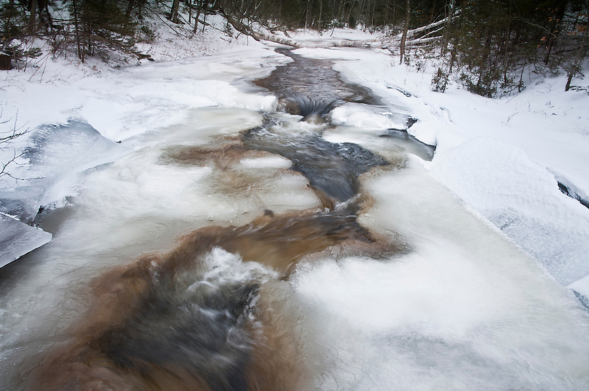 Chapel Creek in winter near its mouth at Lake Superior in Pictured Rocks National Lakeshore near Munising Michigan.