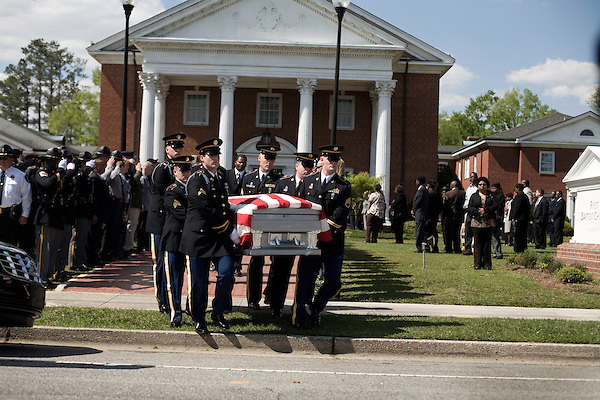 April 15, 2008. Wallace, NC..Funeral services were held for National Guard Staff Sgt. Emanuel Pickett at the 1st Baptist Church in Wallace, NC., where he was a police officer.. SSgt. Pickett was killed on April 6, 2008 in Baghdad, Iraq by indirect enemy fire. He was assigned to the 1132nd Military Police Company, North Carolina Army National Guard, Rocky Mount, N.C. and is the 8th North Carolina National Guard soldier killed in the wars in Iraq and Afghanistan.. Local police officers and community members line the walkway of the church as SSgt. Pickett's casket is brought out.