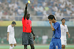 07 August 2008: Referee Badara Diatta (SEN) (left) shows a yellow card to Keisuke Honda (JPN) (8).  The men's Olympic team of the United States defeated the men's Olympic soccer team of Japan 1-0 at Tianjin Olympic Center Stadium in Tianjin, China in a Group B round-robin match in the Men's Olympic Football competition.