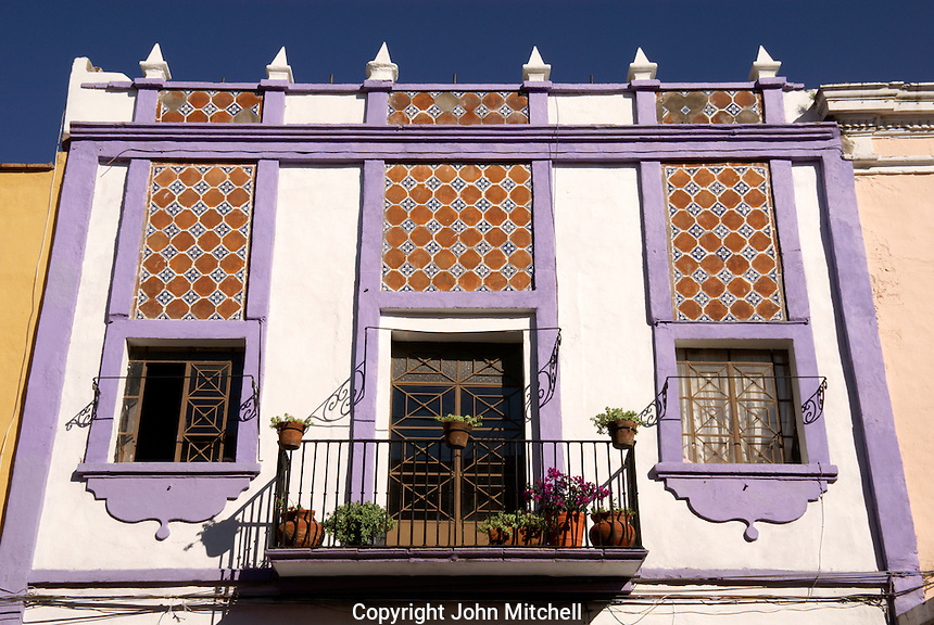 Talavera tiled facade of a house in the city of Puebla, Mexico. The historical center of Puebla is a UNESCO World Heritage Site..