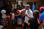 James Kpanaku, a counselor for the HIV/AIDS Program of the Lutheran Church in Liberia, uses a megaphone to carry out public education in the market in Kakata, Liberia. His message encourages prevention and focuses on fighting the stigma and discrimination often associated with the disease.