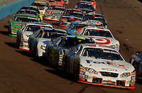 Nov 13, 2005; Phoenix, Ariz, USA;  Nascar Nextel Cup driver Denny Hamlin driver of the #11 FedEx Chevy during the Checker Auto Parts 500 at Phoenix International Raceway. Mandatory Credit: Photo By Mark J. Rebilas