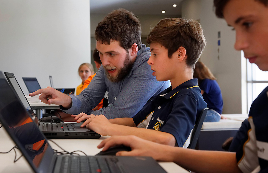 CoderDoJo, a volunteer led coding club for kids where they learn to code. One of the WA chapters is held at Woodsides' Perth HQ. Software engineer and volunteer mentor Theo Wilson with Ross Watson (13). photo by Trevor Collens 8/12/2016
