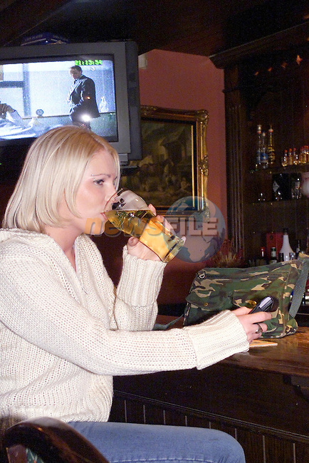 Trase O'Rourke having a drink on her own in the emett tavern in Trim.For Woman Mag..Picture Fran Caffrey Newsfile.