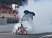 Feb 8, 2014; Pomona, CA, USA; NHRA top fuel dragster driver Clay Millican during qualifying for the Winternationals at Auto Club Raceway at Pomona. Mandatory Credit: Mark J. Rebilas-