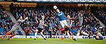 Nicky Clark gets his head to the ball as Lee McCulloch is poleaxed behind