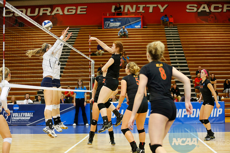 12 DEC 2015:  Lauran Graves (25) of Wheeling Jesuit University hits a kill against Palm Beach Atlantic University during the Division II Women's Volleyball Championship is held at the Martinez Athletic Center on the University of Tampa campus in Tampa, FL.  The Wheeling Jesuit University Cardinals defeated the Palm Beach Atlantic University Sailfish 3-0 for the national title.  Matt Marriott/NCAA Photos